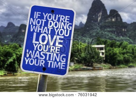If You're Not Doing What you Love You're Wasting your Time sign with a forest background
