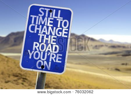 Still Time To Change the Road You're On sign with a desert background