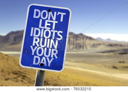 Don't Let Idiots Ruin Your Day sign with a desert background