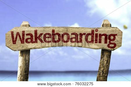 Wakeboarding sign with a beach on background