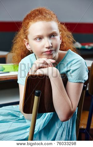 Bored girl sitting in elementary school class