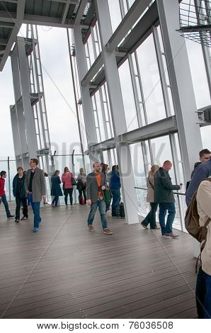 LONDON - 09 JUNE 2013: Tourists sightseeing on the observation deck of the Shard in London, England standing looking out from the glass sides on 09 June 2013