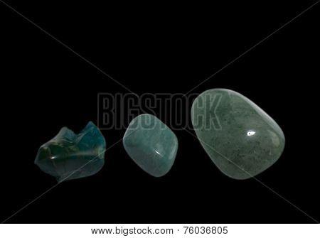 Three green stones