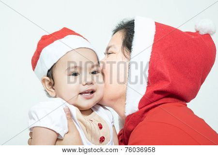 Happy Christmas Mother Kissing Daughter On A White Background