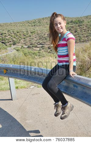 Teenage Girl On Relaxing By The Road