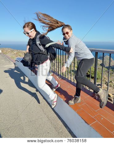 Teenage Sisters Enjoing The Costa Brava Winds