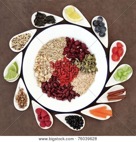 Large weight loss and diet super food selection in white bowls  over lokta paper background.