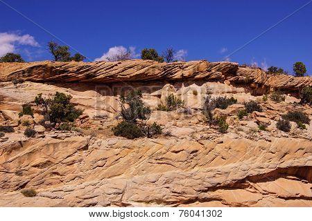 Tilted Layers Of Sandstone Cliffs