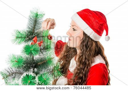Christmas. Beautiful Woman In Santa Costume Decorating Christmas Tree. X-mas, Winter, Happiness Conc