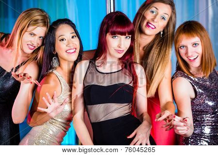 Beautiful women dancing in discotheque or club
