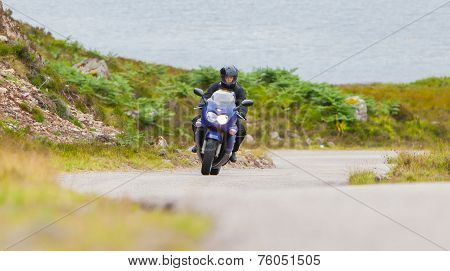 Motorcyclist In The Scottish Highlands