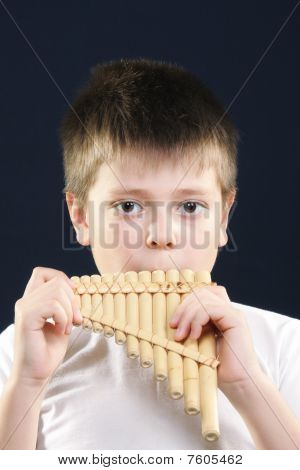 Boy In White Playing Panflute