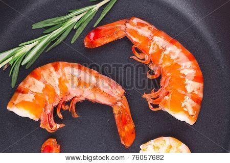 Fragment of shrimps on frying pan.