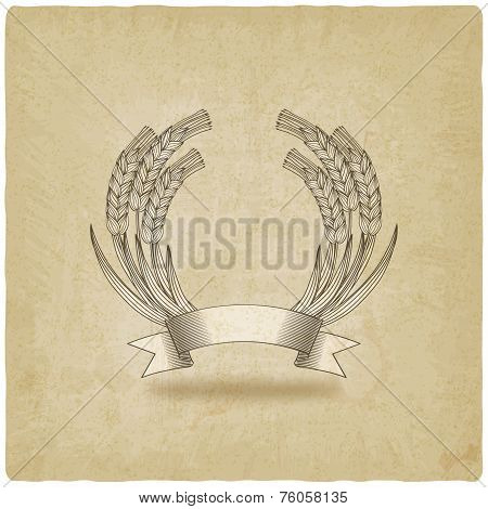 sheaf of wheat with ribbon old background