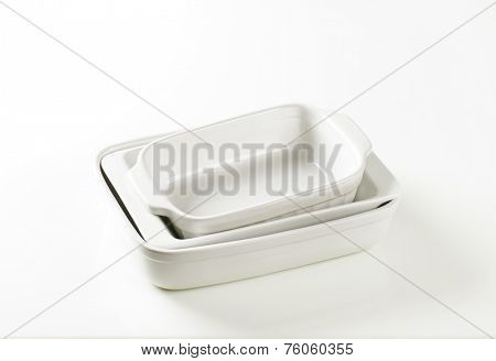 empty baking trays on white background