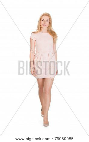 Attractive Woman Walking Against White Background