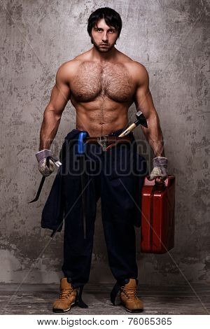 Guy with perfect body holding jerrycan