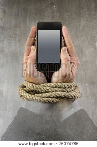 Hands Of Businessman Addicted To Mobile Phone Rope Bond Wrists In Smartphone Internet Addiction