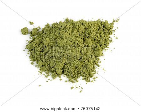 Macro Closeup Of Organic Wheatgrass Powder Isolated Against White Background