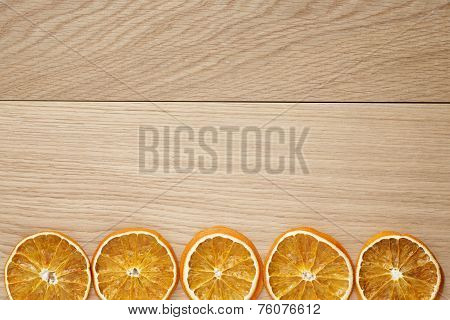 Dried Orange Slices On Natural Oak Table