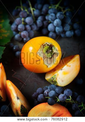 Persimmon And Grapes Still Life.autumn Season Food Photo