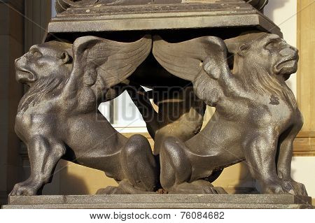 Two Griffins Form The Foot Of A Magnificent Candelabra