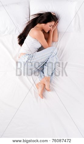Woman sleeping in fetal position