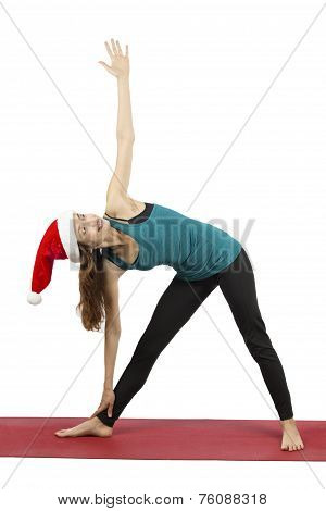 Christmas Yoga Woman Doing Extended Triangle Pose