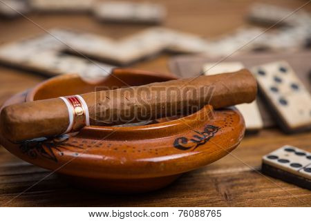Cigar In Ash Tray And Domino In Background