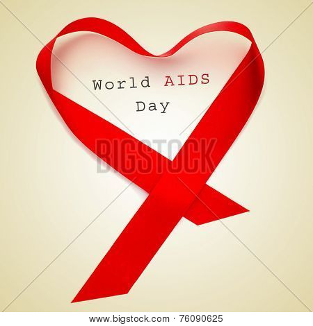 a red ribbon forming a heart and the text world AIDS day on a beige background