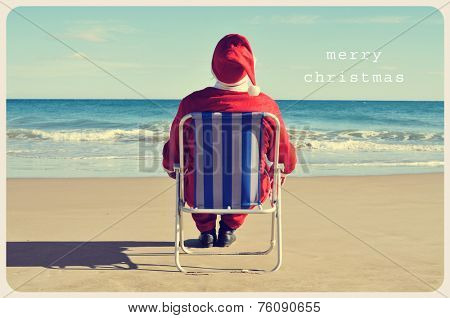 a picture of santa claus sitting in a beach chair on the beach and the text merry christmas like a postcard