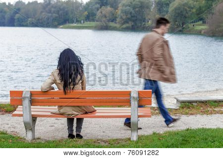 a young woman sitting on a park bench