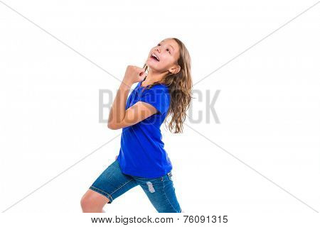Excited winner expression kid girl gesture running with blue jeans on white background