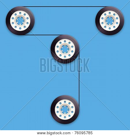 A vector illustration of a recordable bobbin of tape cassette. Letter T