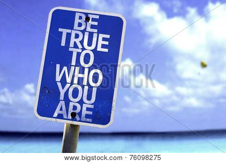 Be True To Who You Are sign with a beach on background