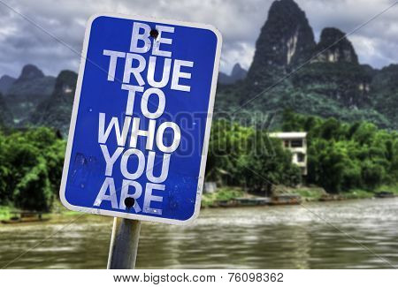 Be True To Who You Are sign with a forest background