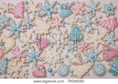 Pastel colored cookies on a white wooden background