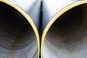 stock photo of orifice  - Two new metal pipes with yellow - JPG