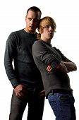 picture of gay couple  - Sexy attractive young gay couple isolated studio image - JPG