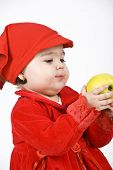 Baby Girl Holding An Apple