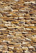 stock photo of gneiss  - Colorful stone wall closeup in sunny day - JPG