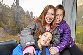 stock photo of three sisters  - Portrait of three siblings  - JPG