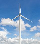 stock photo of wind-farm  - The wind turbine standalone with cloudy blue sky background in the wind farm Thailand largest wind farm in South East Asia - JPG