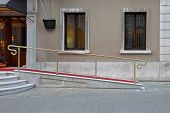 foto of wheelchair  - Wheelchair ramp with red carpet for easy access in building - JPG