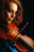picture of musical instrument string  - Playing the violin - JPG