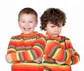 foto of mood  - Pair of twins dressed alike with varying degrees of mood - JPG