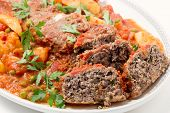 stock photo of baked potato  - Homemade meatloaf baked in tomato sauce with peas and potatoes on a dish - JPG