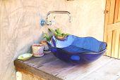 pic of wash-basin  - Blue hand basin made blue glass in bathroom - JPG