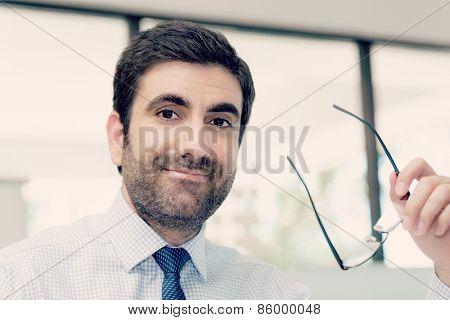Handsome businessman sitting in office