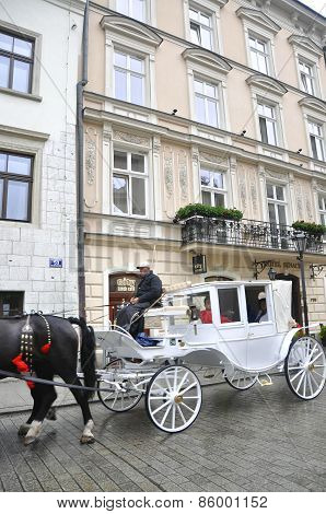 KRAKOW,POLAND-AUGUST19:Sightseeing Carriage in Krakow,Poland on august 19,2014